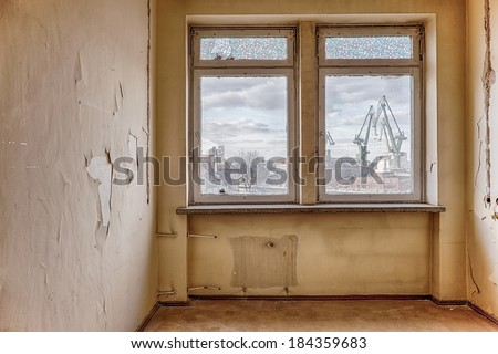 Interior of an old, ruined building - view from the window - stock photo