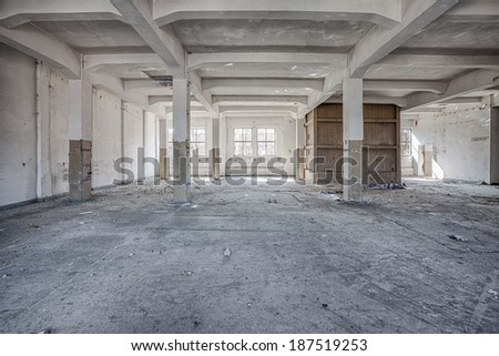 Interior of an old, ruined factory - stock photo