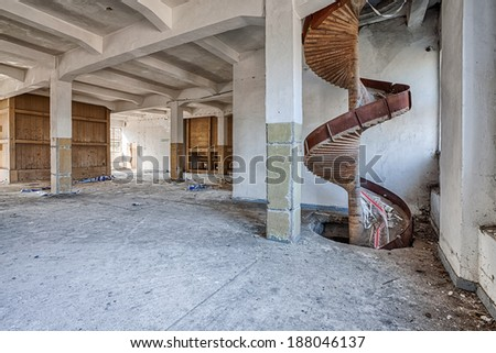 Interior of an old, ruined mill - stock photo