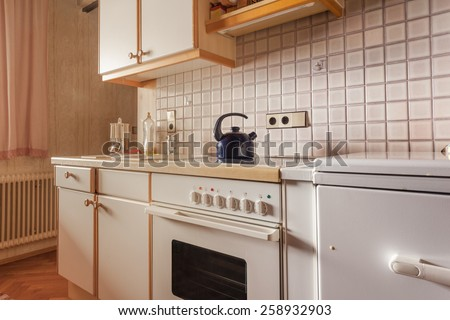 interior of an old simple kitchen that should be renovated - stock photo