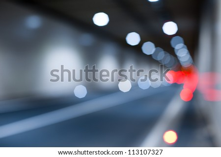 Interior of an urban tunnel without traffic from - light bokeh - stock photo