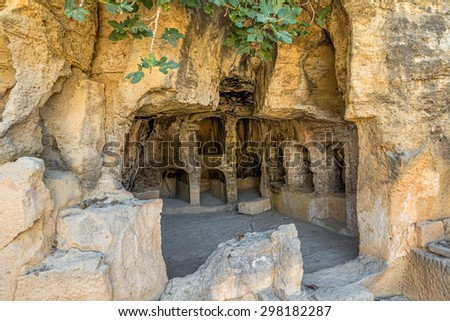 Interior of ancient remains of the Tombs of the Kings at Paphos, Cyprus. - stock photo