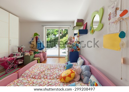 Interior of apartment, children room with many toys - stock photo