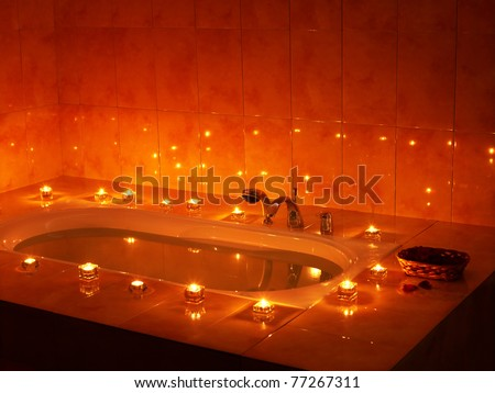 Interior of bath tub with candle. - stock photo
