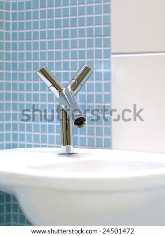 Interior of bathroom - basin and faucet - stock photo