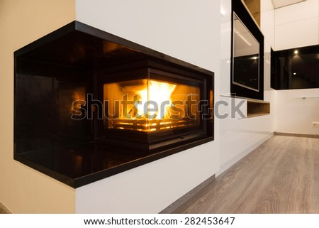 interior of beautiful modern living room with fireplace - stock photo