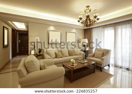 interior of beige living room - stock photo