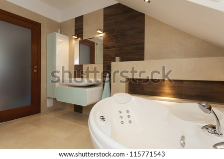 Interior of contemporary bathroom with white bathtub - stock photo