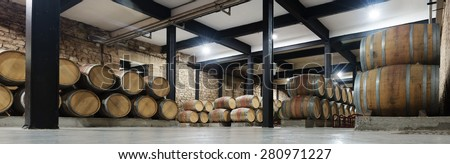 Interior of  contemporary winery with  many wooden barrels - stock photo