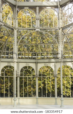 Interior of Crystal Palace (Palacio de cristal) in the Retiro Park in Madrid. Spain. It was built in 1887 to exhibit flora and fauna from the Philippines. The architect was Ricardo Velazquez Bosco. - stock photo