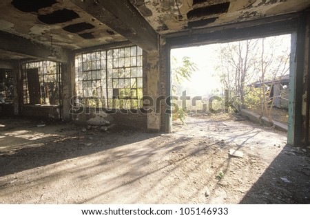 Interior of decaying abandoned factory, East St. Louis, Missouri - stock photo