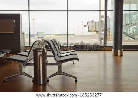 interior of departure lounge at the airport - stock photo