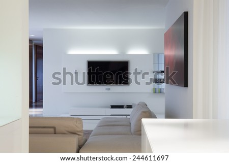 Interior of designed living room with tv - stock photo