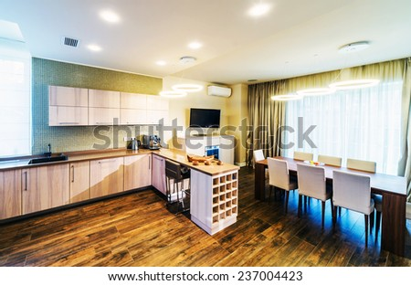 interior of dinning room with cuisine part of luxury apartment  - stock photo