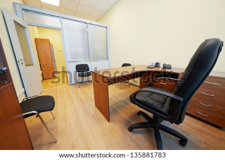 Interior of empty office cabinet with black armchair - stock photo