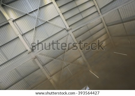 Interior of empty warehouse, industrial background, shiny floor in depot with reflections, construction in reflection - stock photo