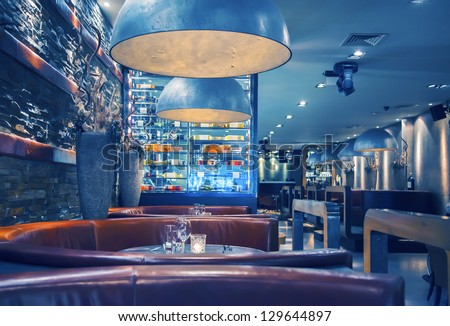interior of evening  restaurant with decorative lamps - stock photo