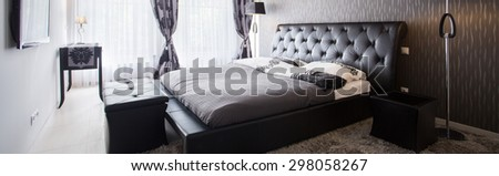 Interior of exclusive bedroom in luxury hotel - stock photo