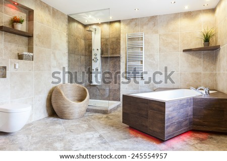 Interior of expensive and brown bathroom, horizontal - stock photo