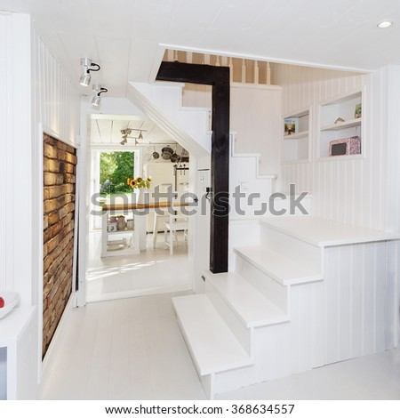 interior of fancy apartment stairs and a wall of hood - stock photo
