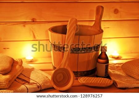 interior of finnish sauna and sauna accessories - stock photo