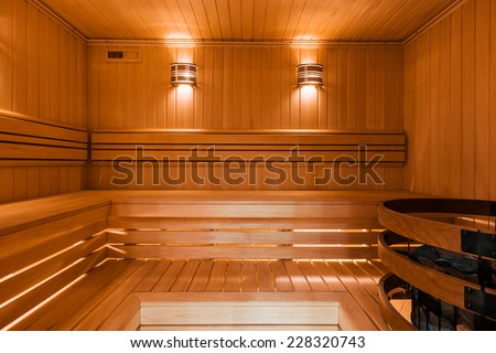 Interior of Finnish sauna, classic wooden sauna - stock photo