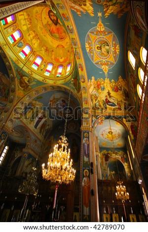 Interior of Greek orthodox Church - stock photo