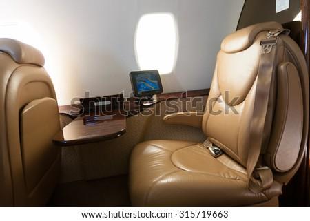 Interior of jet airplane - stock photo
