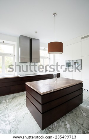 Interior of kitchen with brown furniture - stock photo