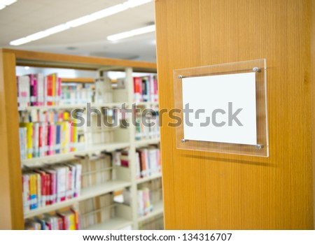 Interior of library with book shelves and books. - stock photo
