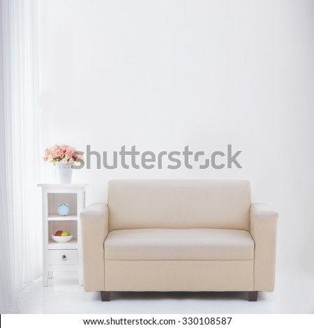 interior of living room with blank wall on top of the couch - stock photo