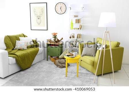Interior of living room with couch and armchair - stock photo
