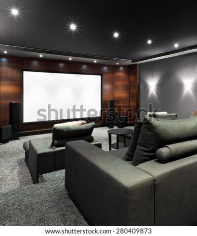 Interior of luxury home theater - stock photo