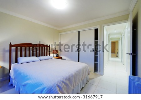 Interior of master bedroom with king size bed - stock photo