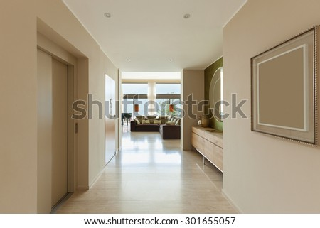 Interior of modern apartment , living room view from corridor - stock photo