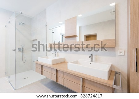 interior of modern bathroom with shower - stock photo