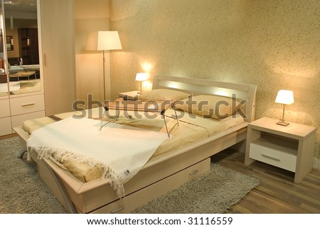Interior of modern bedroom with furniture and lamps. Warm and pastel colors, calm and relaxing atmosphere. - stock photo