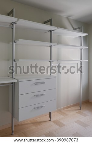 Interior of modern empty light wardrobe room - stock photo