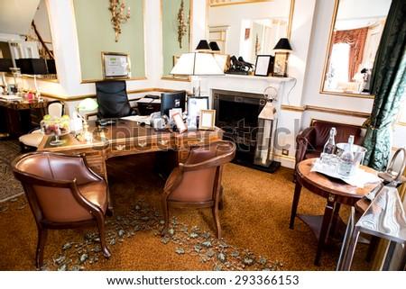Interior of modern hotel reception desk - stock photo