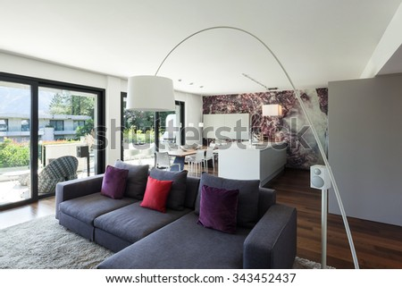 Interior of modern house, beautiful living room furnished - stock photo