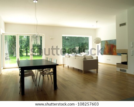 Interior of modern house, dining room, living room - stock photo
