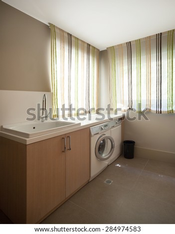 interior of modern house, laundry room with sink - stock photo
