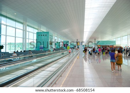 Interior of modern International Airport. No recognizable faces and advertising - stock photo