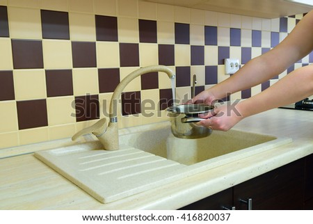 Interior of modern kitchen. Water collect to the pan - stock photo