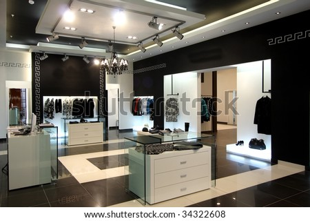 Interior of modern shop of clothes - stock photo