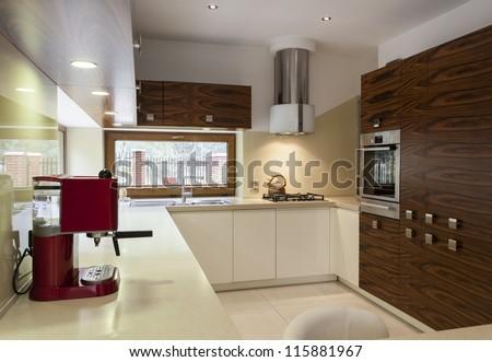 Interior of modern, stylish kitchen with wooden cupboards - stock photo