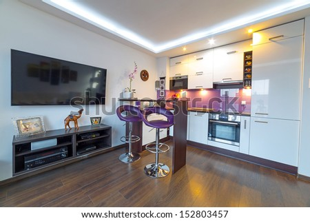 Interior of modern white living room with kitchen  - stock photo