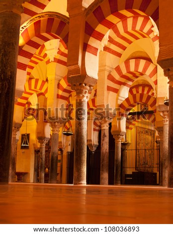 interior of Mosque (Mezquita) cathedral of Cordoba, Spain in candlelight - stock photo