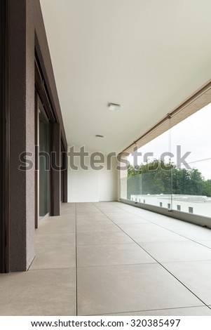 interior of new apartment, balcony seen from the outside - stock photo