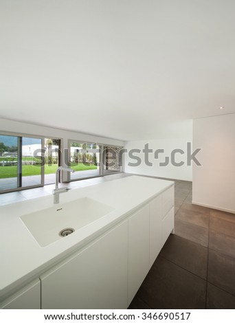 interior of new apartment, modern domestic kitchen - stock photo